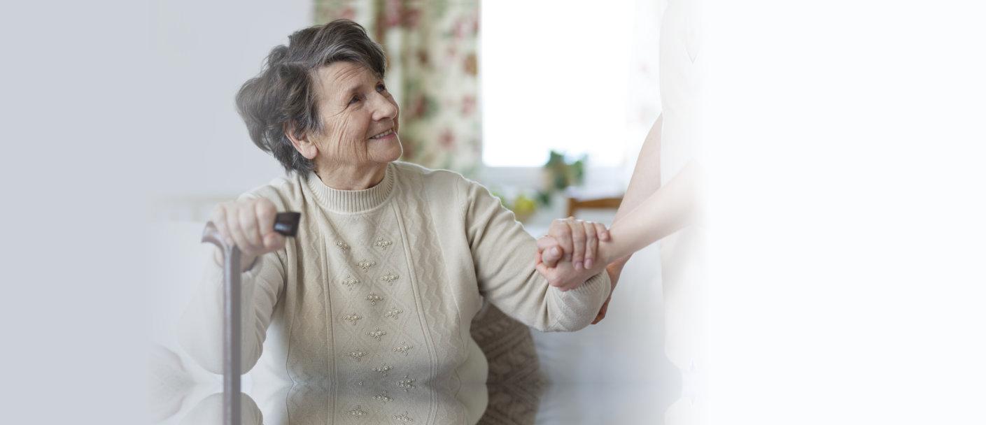 caregiver having discussion with senior man
